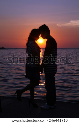 Silhouette couple kissing - stock photo