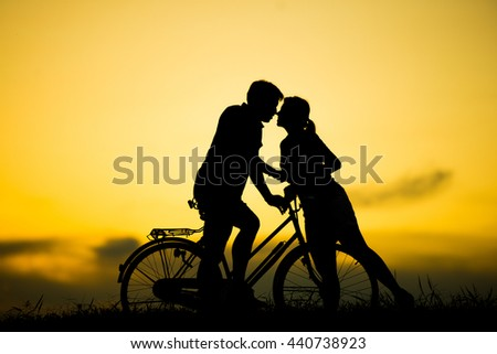 silhouette couple love. kissing at beautiful sunset time.