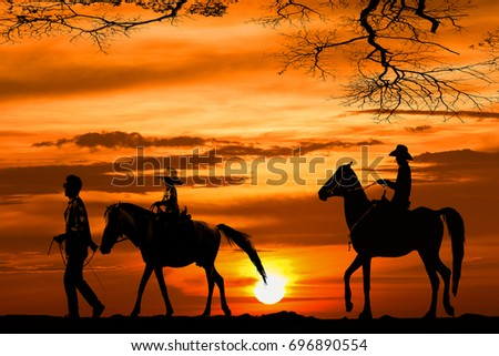 silhouette cowboy riding a horse on sunset