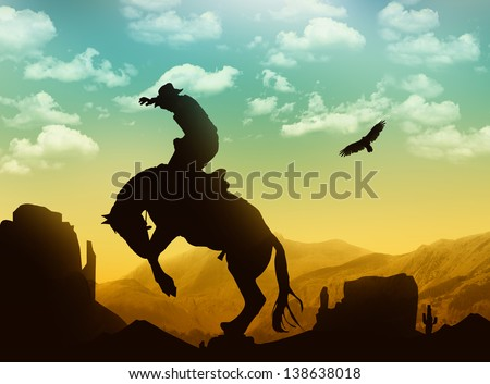 Silhouette cowboy with horse in the sunset - stock photo