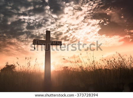 Silhouette cross on blurred amazing light background.  Merry Christmas Card Thankful Adoration Glorify Peace Evangelical Hallelujah Blessing Amen Hope Religion Hosanna concept - stock photo