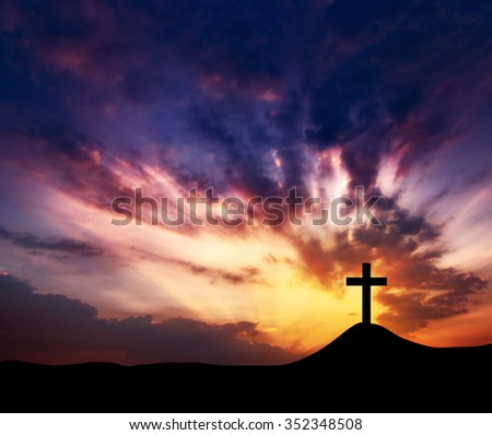 silhouette crosses on a hill, copy space. - stock photo