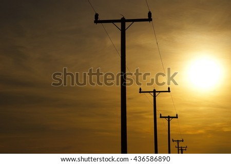 silhouette electric poles at sunset