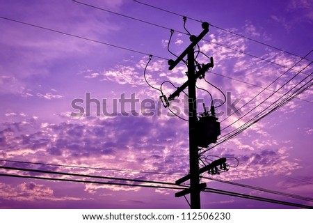 silhouette electricity post - stock photo