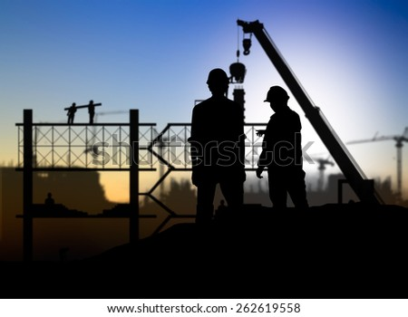 silhouette engineer looking construction worker in a building site over Blurred construction site - stock photo