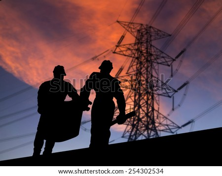 silhouette engineering looking at blueprints in a building site over Blurred construction  site - stock photo