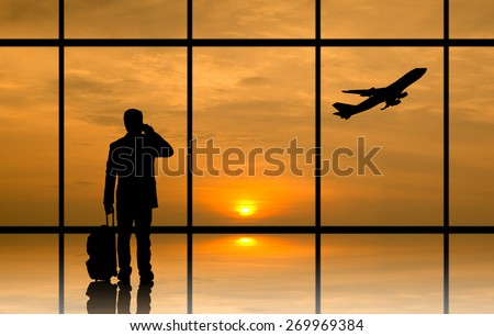 Silhouette executive businessman prepare to connect his business with sunrise - stock photo