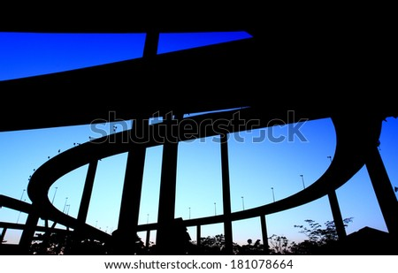 silhouette expressway many routes overlap sunset background - stock photo