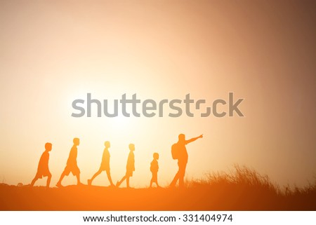 Silhouette father walking with children go to travel - stock photo