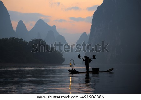 Silhouette Fisherman and Cormorant in Guilin China.