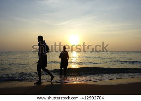 Silhouette fisherman casting morning:select focus with shallow depth of field.