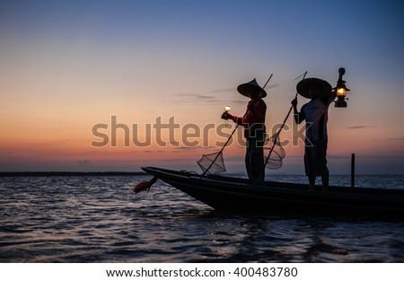 Silhouette fisherman evening lamps, of fishing gear.