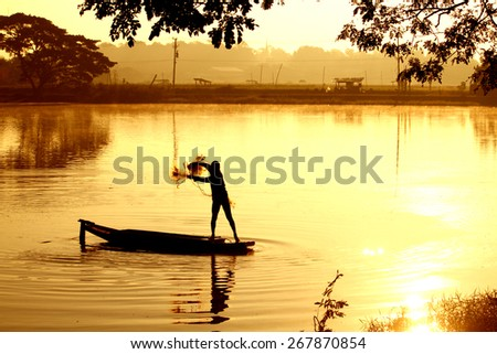 Silhouette fishermen fishing in the pond - stock photo