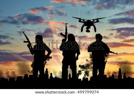 Silhouette flying reconnaissance drone over city in a smoke and a terrorists. Concept of military intelligence and terrorist information