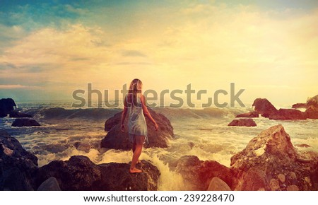 silhouette girl back at the sea - stock photo
