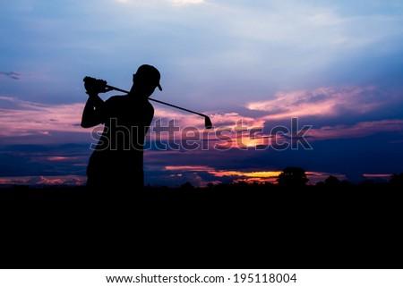 silhouette golfer at beautiful sunset  - stock photo