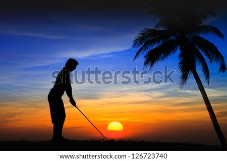 Silhouette golfer at sunset - stock photo