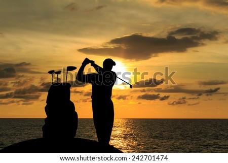 silhouette golfer  beautiful sky backlit sunset background - stock photo