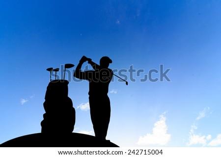 silhouette golfer  beautiful sky backlit sunset background. - stock photo