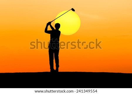 silhouette golfer playing golf on sunset - stock photo