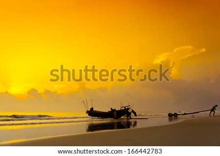 silhouette group of fisherman at work on great sunrise