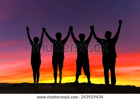 Silhouette group of people - stock photo
