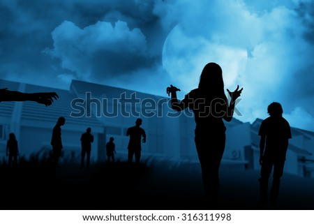 Silhouette group of zombie walking under full moon. Halloween concept - stock photo