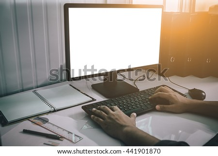 Silhouette hand business man working with smart phone and computer to work wireless. Press OK Trading smartphone and computer. Concept boundless business and technology flare light.selected focus. - stock photo