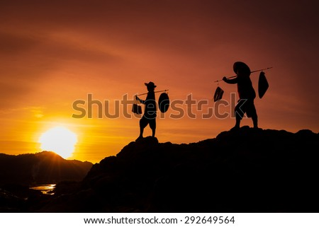 Silhouette human carry basket at sunset