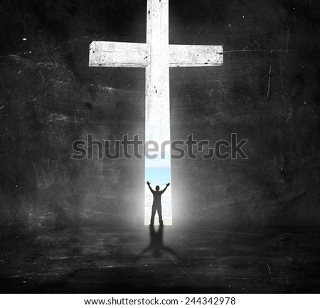 Silhouette human raising hands over the white cross in dark room and looking the beach. - stock photo
