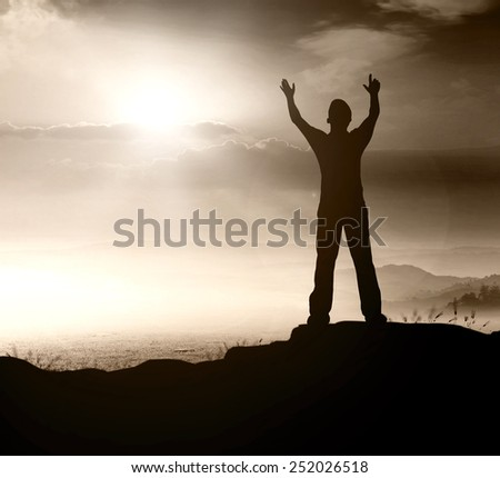 Silhouette human standing over nature background. - stock photo