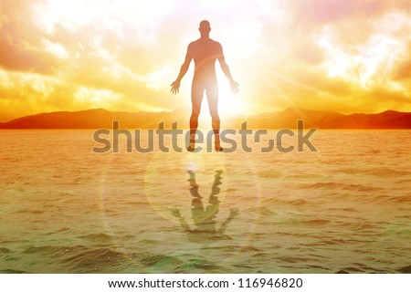 Silhouette illustration of human figure floating on water - stock photo