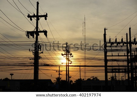 Silhouette image blur of electric station with colorful sky in twilight  time:select focus with shallow depth of field. - stock photo