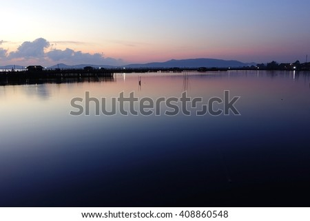 Silhouette image Lake view  in the morning with Sunrise background,Songkhla Lake Songkhla Southern Thailand:select focus with shallow depth of field:Ideal use for background.