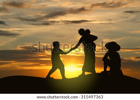 Silhouette image of farmer family in sunset. father sitting near mother holding child and boy.