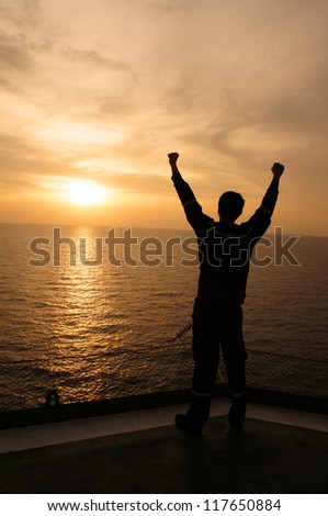 Silhouette Image of Man Raising His Hands - Signs of Successful and Happiness - stock photo