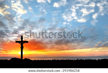 Silhouette Jesus and the cross over sunset - stock photo