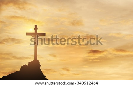Silhouette Jesus and the cross over sunset on mountain top - stock photo