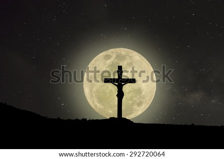 Silhouette Jesus and the cross over the full moon - stock photo