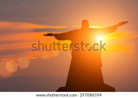 Silhouette Jesus and the sunset - stock photo