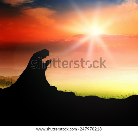 Silhouette Jesus Christ of Nazareth kneeling and praying at garden of gethsemane background. Helper, Amazing Grace, Thanksgiving, Christmas, Forgiveness, Mercy, Humble, Reconcile, Trust, Love concept. - stock photo