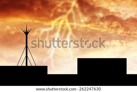 silhouette lightning rod. orange sky background - stock photo