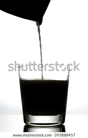 silhouette liquid milk from box into a glass