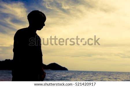 Silhouette man at the beach.
