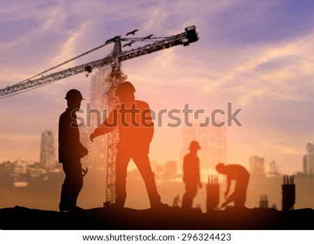 silhouette man construction worker in a building site over Blurred construction worker on construction site