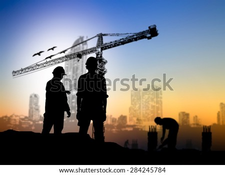 silhouette man engineer construction site over Blurred construction worker on construction site - stock photo