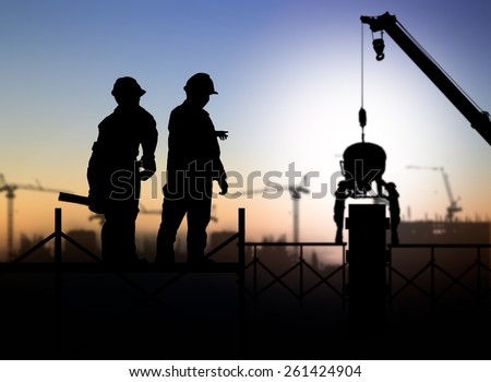 silhouette man engineer looking a building site over Blurred construction worker on construction site - stock photo