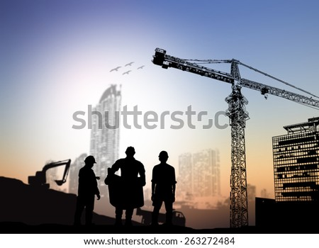 silhouette man engineer looking at blueprints Blurred construction site - stock photo