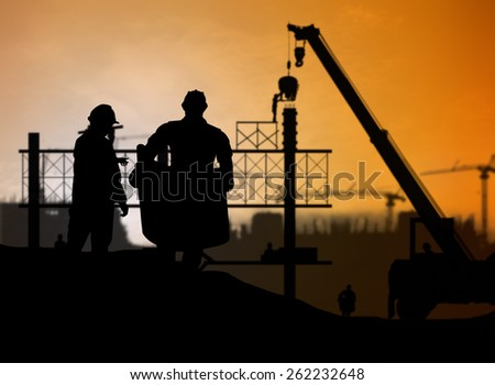 silhouette man engineer looking construction worker in a building site over Blurred construction site