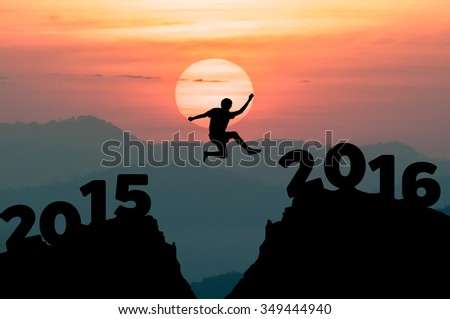 Silhouette man jumps to the New Year 2016 with sunrise - stock photo
